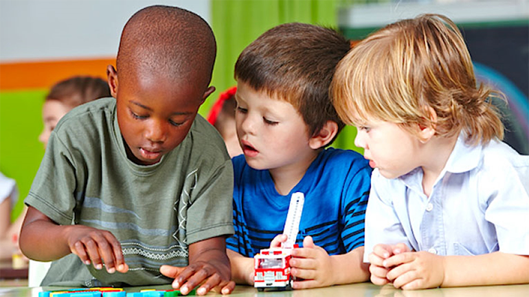 three kids in the classrom